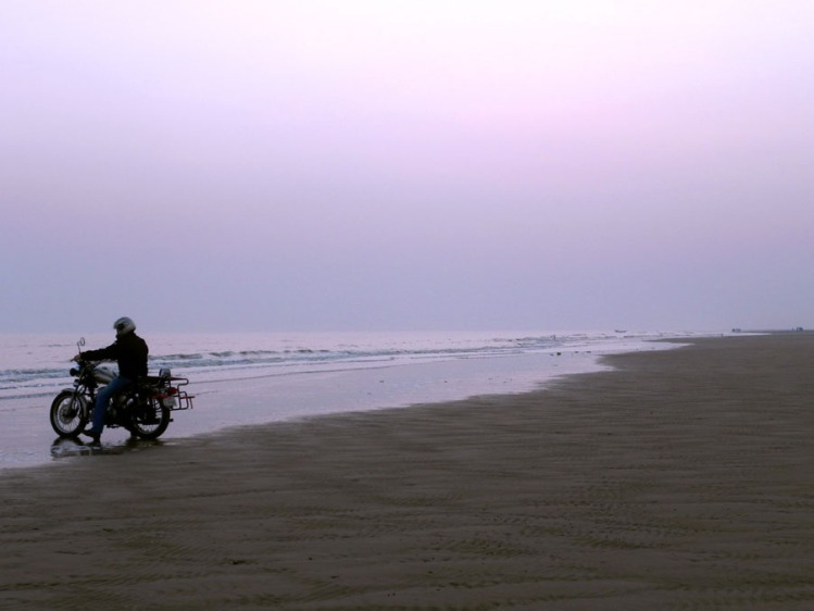 An evening ride along the firm sands of Mandarmani beach, part of our road trip up India's east coast
