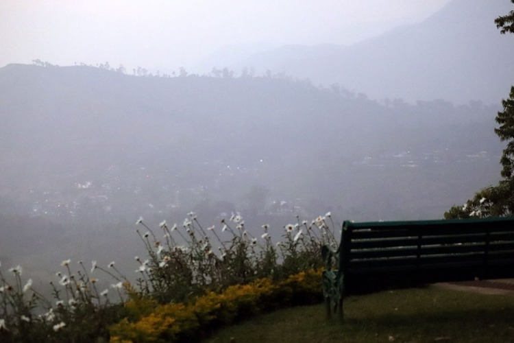 Bench with a hilltop view at Sinna Dorai's Bungalow, Valparai, Tamil Nadu, India